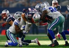 New England Patriots vs. Dallas Cowboys - Photos - October 11, 2015 - ESPN  -    ARLINGTON, TX - OCTOBER 11: Rob Gronkowski #87 of the New England Patriots is tackled by Byron Jones #31 of the Dallas Cowboys and Morris Claiborne #24 of the Dallas Cowboys during the second half of the NFL game at AT&T Stadium on October 11, 2015 in Arlington, Texas. (Photo by Mike Stone/Getty Images)