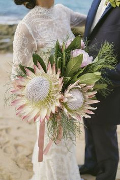 How pretty are these unique flowers that add a touch of pink to the bride's bouquet?