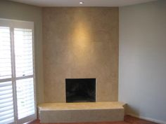 """Just completed tiling a gas fireplace surround in 18 x 18"""" marble tile from floor to ceiling"""