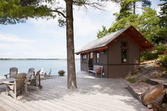 Great setting for a small cottage on the waterfront along with nice decking.