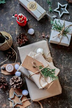 Wrapping christmas gift by Babett Lupaneszku - Stocksy United Christmas Gift Wrapping, Christmas Presents, Christmas Decorations, Present Wrapping, Christmas Time Is Here, Gift Packaging, Seasonal Decor, Royalty, Wraps