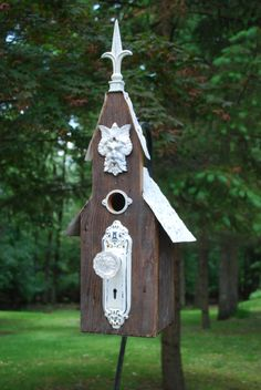 A metal portal protector around birdhouse entry hole keeps squirrels from enlarging the hole.  Antique Church Style birdhouse by nelotcram on Etsy