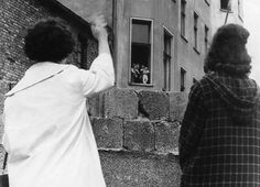 The Wall divided families. In this Aug. 26, 1961 photo, two women in West Berlin wave to family over the Wall.