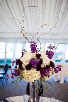 Tall elevated purple floral centerpiece by Sophisticated Floral