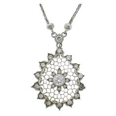 This a beautifully delicate necklace illustrating M. BUCCELLATI'S classic pierced honeycomb design with diamond accents.