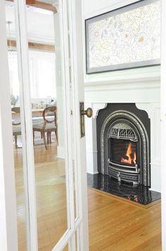 Fireplace design by Madeleine Design Group Renovations, Functional Kitchen, Fireplace Design, Homey, Dining Nook, Wood Accents, Fireplace Surrounds, Fireplace, Character Home