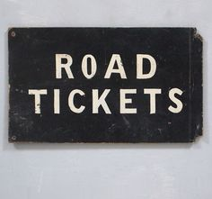 Vintage painted black and white railway sign: Road Tickets