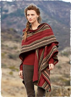 Our dramatic ruana is pattern-striped in textural, tweeded stitches for the authentic look of the Andean original. Rendered in gorgeous shades of crimson, wine, teal and sand. Fine gauge knit of pima (66%), baby alpaca (24%) and wool (10%).