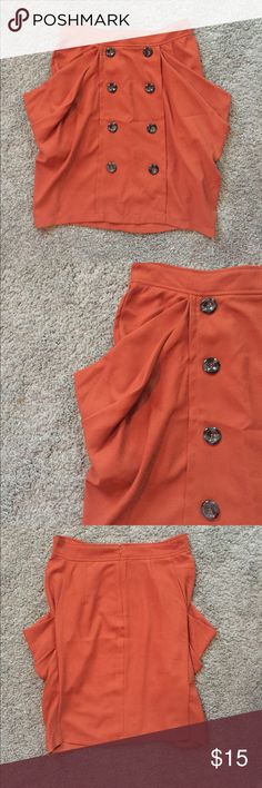 Orange skirt with peplum pockets & sailor buttons A burnt orange knee length skirt with double paneled buttons and peplum style pockets. This skirt or fitted, but loose enough to be comfortable and give that easy boho look. Double Zero Skirts Midi