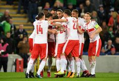 Ricardo Rodriguez of Switzerland celebrates with team mates after he scores his sides first goal during the FIFA 2018 World Cup Qualifier Play-Off: First Leg between Northern Ireland and Switzerland at Windsor Park on November 9, 2017 in Belfast, Northern Ireland.