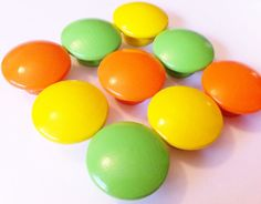 Hand Painted Dresser Knobs - Orange, Lime Green and Yellow.   The Little Nursery $2.50 each.  Looks like M.