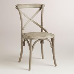 """Both elegant and rustic, our """"X"""" back dining chairs are crafted of oak with a distressed finish and a comfortable, woven rattan seat finished with a graywash."""