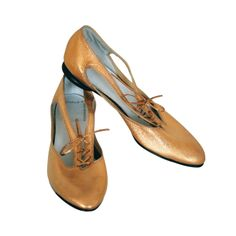1960's Rudi Gernreich Metallic Gold Leather Cut-Out Mod Shoes | From a collection of rare vintage shoes at http://www.1stdibs.com/fashion/accessories/shoes/