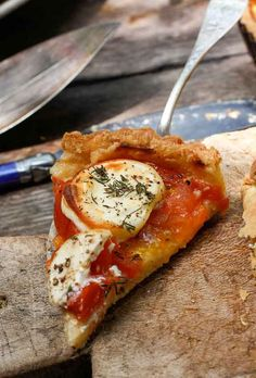 A summertime French-inspired Fresh Tomato Tart, baked in a buttery crust with rounds of cheese & fresh herbs--direct to you from the sunny south of France!