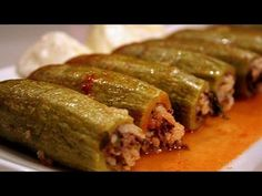 The best zucchini to use for this recipe is the small, slightly bulbous, pale green variety often sold as Lebanese zucchini. Hollow out the zucchini using a ...