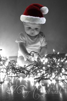 "Unique Christmas Card Picture ideas. I know I don't have ""babies"" like this anymore but still think it would be cute to have all the kids surrounded by lights and ornaments and use that as a Christmas card."