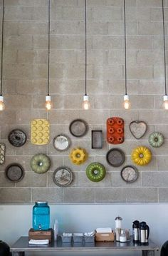 Vintage cake moulds on a kitchen wall