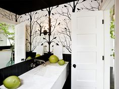 Get this look with an inexpensive 4x4 field tile and a graphic wallpaper. The black ceiling is bold; maybe a little too claustrophobic for me. Home of designer Jessica Helgerson (love her!)