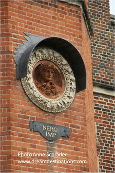 Nero Imp  Hampton Court Palace England.  In the late 1510s, Cardinal Thomas Wolsey (the orginal owner of the palace)  commissioned the Italian sculptor Giovanni da Majano to create eight painted and gilded terracotta roundels.  Each roundel represented the bust of a Roman emperor.