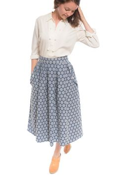 The Wedgwood sewing pattern by Straight Stitch Designs is a high-waisted, pleated skirt with pockets, a center back zipper, and two lengths.