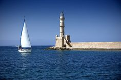 The Egyptian Lighthouse in the Venetian port of Chania - an absolute jewel of the city and the most photographed monument. Crete Chania, Old Port, Burj Khalifa, Greek Islands, Greece Travel, Lighthouses, Cn Tower, Venetian, Egyptian