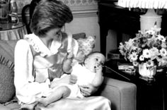 Diana holding William in 1982 at Kensington Palace.