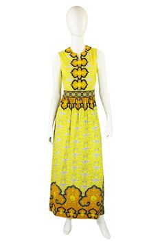 1970s Mr Dino Jersey Print Maxi Dress ~ The poly jersey is fluid & light.  It drapes well and moves wonderfully!!  A-lined skirt; sleeveless.  The design really reflects the feel of that time. The print is vivid yellow, accented by mustard, black and white. The design swirls over the entire piece and it has an almost Moroccan style to it.  The colors are crisp.