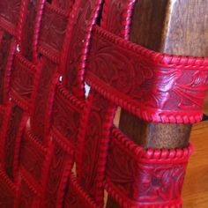 Tooled red leather chair.