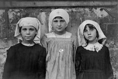 St. Sulpice, Secours de Guerre. Refugee children living here playing as Red Cross nurses in August of 1918.