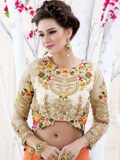 Delightful cream color art silk blouse glamorized with zari, kundan work. Item code:BHP148 http://www.bharatplaza.com/new-arrivals/accessories.html