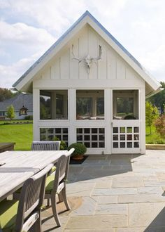 A new timber frame home in Ohio blends a couple's affection for barn-style design, primitive antiques and laid-back country living.