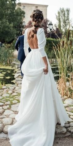 Simple Wedding Dresses For Elegant Brides ★ simple wedding dresses a line with sleeves open back country kiwo estudio dresses simple sleeves 30 Simple Wedding Dresses For Elegant Brides Boho Wedding Dress With Sleeves, How To Dress For A Wedding, Stunning Wedding Dresses, Long Sleeve Wedding, Princess Wedding Dresses, Modest Wedding Dresses, Dresses With Sleeves, Bride Dress Simple, Simple Wedding Gowns