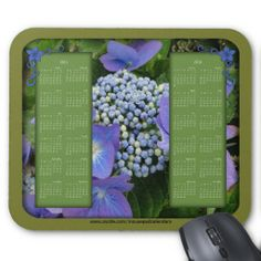 2015-2016 Calendar Mouse Pad-Blue Hydrangea $14.95 24 month, Keep the entire year right at your fingertips with a decorative mouse pad from zazzle. This calendar has a solid color main background. The center background is blue hydrangea flowers in the garden. This calendar mouse pad is available for other calendar years as well. See my store for a calendar like this with the addition of a photo frame for you to personalize with a photo of your choice. Feel free to add text as well.