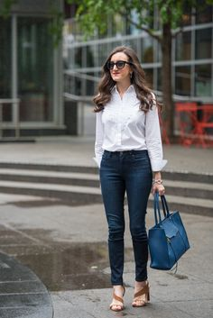 Casual classic outfit ideas for women. Wearing a white button up shirt with dark wash skinny jeans and blue tote http://baublestobubbles.com/2017/05/08/classic-style-outfit-ideas/?utm_campaign=coschedule&utm_source=pinterest&utm_medium=Olivia%20Johnson%20-%20Baubles%20to%20Bubbles&utm_content=Casual%20Sophistication