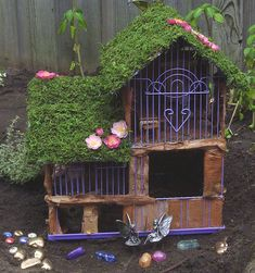 Something a little different - fairy house using parts of a bird cage? poster says she'll provide instructions if you want them