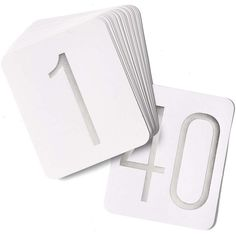 White table cards with silver foil numbers