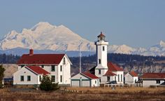 """""""Mt. Baker behind Point Wilson Lighthouse in Port Townsend, Washington."""" (From: 30 Travel-Inspiring Photos of Mountains)"""