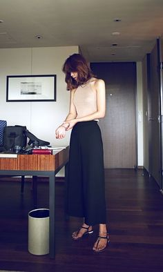 Cut in nude top, flare pants that end off at just the right part of the ankles and sandals