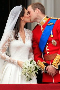 The newly-titled Duke and Duchess of Cambridge appeared on the balcony of Buckingham Palace for the Royal Airforce flypast and to seal their marriage with a kiss.