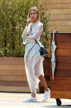 Hailey Baldwin shows off her figure in sheer lacy dress in Malibu Estilo Hailey Baldwin, Hailey Baldwin Style, Stephen Baldwin, Sheer Lace Dress, White Dress, Festival Girls, Dress With Sneakers, Victoria Secret, Girl Fashion