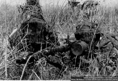 Very well camouflaged MG team waffen SS armed with machine gun MG34
