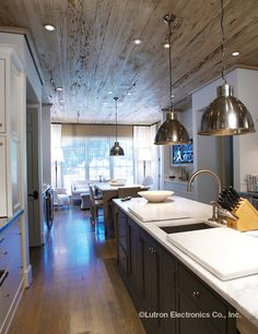 Add texture and warmth to your #kitchen with the addition of recessed lighting from #Lutron and wood-plank ceilings.