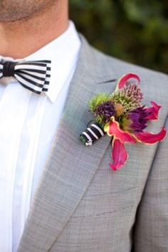 Beautiful + color boutonniere. Obviously can't get enough of the stripes!