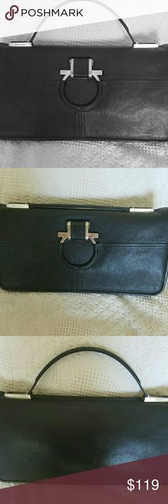 Ferragamo black handbag Never used authentic black Ferragamo briefcase style handbag with adjustable strap so it can be used as a clutch. Silver accents with Ferragamo branding. 15 1/2 inches across and 8 1/2 inches high. Perfect for the professional woman with style! Ferragamo Bags Totes