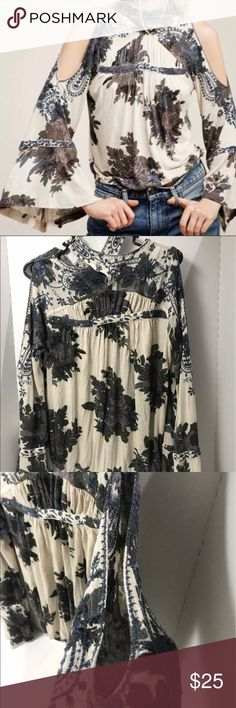 Free People mock neck button long sleeve shirt Free People mock neck button long sleeve boho  shirt with open off the shoulder bell sleeves. Floral with embroidery. This is a very cute shirt and it buttons around neck. Free People Tops Tees - Long Sleeve