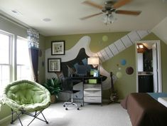 oversized electric guitar mural on wall works for music themed room. green with brown & blue accents.