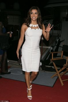 Wowing in white: Eva Longoria looked gorgeous in a curve-hugging white dress as she contin...