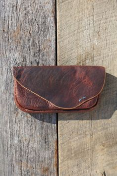 Cambria Handmade - Cambria Harkey hand makes these all bison leather goods back in Austin, TX.