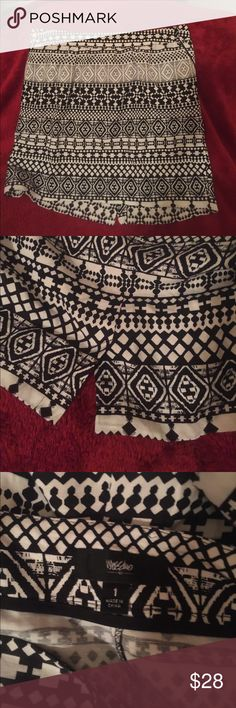 Cute black/white skirt NWOT! NWOT💥super cute black/white skirt with Aztec pattern. Poly blend. Small slit in back and front pockets.  Never worn. Brand new!! Mossimo Supply Co Skirts