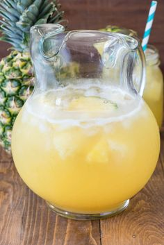 Pineapple Party Punch - the perfect cocktail recipe! Prosecco, Rum, and Pineapple make a perfect party drink. Includes a non-alcoholic version!